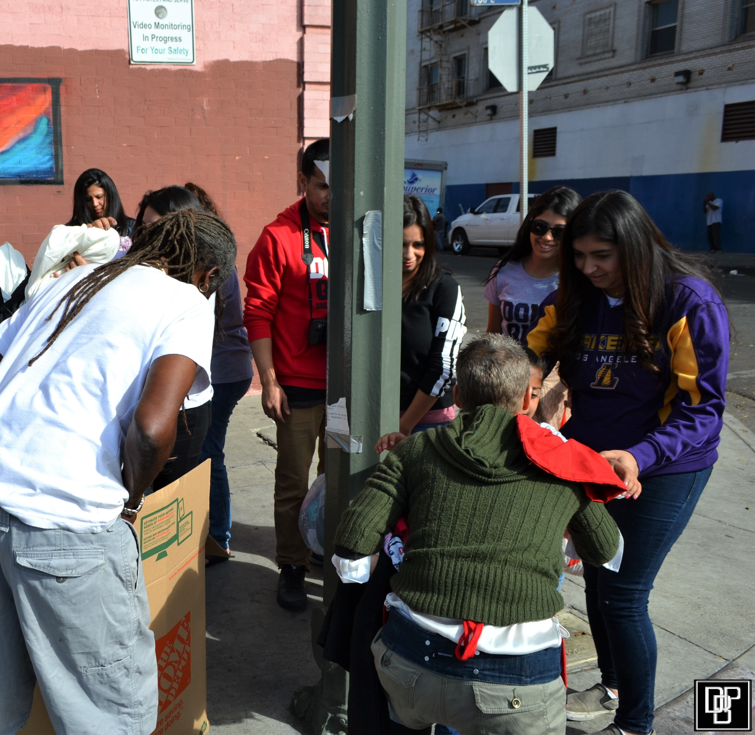 Volunteers help distribute food and clothing. Photo by Manuel Sterling.